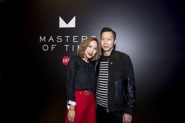 Fashion Influencer Faye Tsui poses with her husband