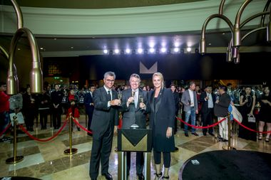 Johan Pretorius, Managing Director, DFS Cotai Limitada; Ed Brennan, Chairman and CEO, DFS Group; Sibylle Scherer, President Merchandising and Consumer Marketing raise a glass