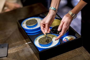 Petrossian caviar ambassador sharing tasting notes with guests