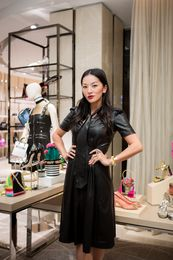 Tina Leung poses with her fashion picks for Fall inspired by the Music Club